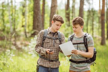 two young tourist determine the route map and navigator